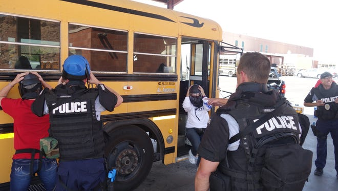 Members of the St. George Police Department and the Washington County School District participated in a safety training exercise before the start of the 2016 school year.