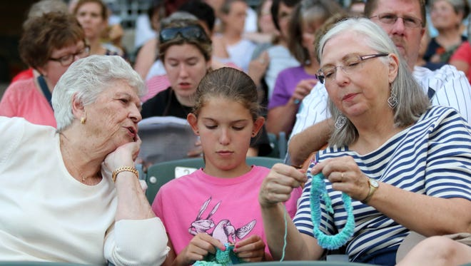 Knitters attend a knit-along to make chemo caps during a Stitch N Pitch game at the Somerset Patriots' TD Bank Ballpark in Bridgewater.