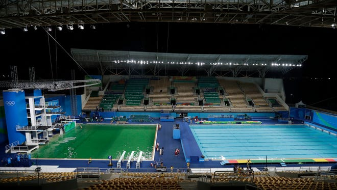 In this Aug. 9, 2016 file photo, the water of the diving pool appears a murky green, in stark contrast to the pool's previous day's color and also that of the clear blue water in the second pool for water polo at the venue as divers train in the Maria Lenk Aquatic Center at the 2016 Summer Olympics in Rio de Janeiro, Brazil. Brazil managed to hold the Games under difficult economic and political conditions, with the sports competitions, venues, friendly people, television images and Rio's scenic backdrops all rising to the occasion. Yet, behind the scenes, the Games fell short in other areas, including green water.
