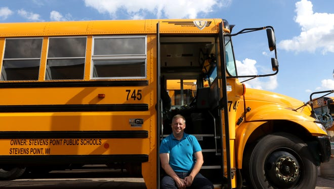 Bradley Carriveau, district transportation director for the Stevens Point School District, poses for a portrait on one of the buses of the Stevens Point Public School District August 16, 2016.