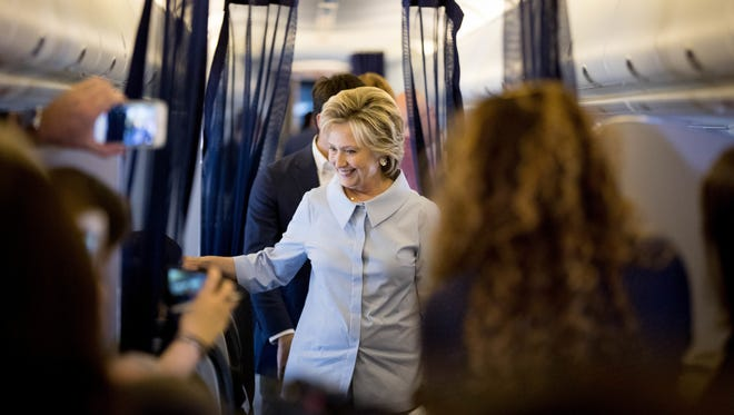 Democratic presidential candidate Hillary Clinton speaks to members of the media on her first flight on a new campaign plane before taking off at the Westchester County Airport in White Plains, N.Y., Monday, Sept. 5, 2016, to travel to Cleveland Hopkins International Airport for Labor Day events.