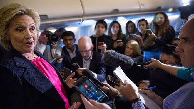 Democratic presidential candidate Hillary Clinton answers a question from a member of the media on board her campaign plane as she travels to Tampa International Airport in Tampa, Tuesday, Sept. 6.