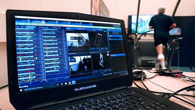 In this Friday, Aug. 12, 2016 photo, a computer screen shows sensor readouts of David Moran running on a treadmill in Ann Arbor, Mich. A University of Michigan lab, The Michigan Performance Research Laboratory, which is part of the School of Kinesiology, is offering runners an in-depth assessment designed to help them improve their form. The consultations last around two hours and include footwear, musculoskeletal and postural evaluations by a physical therapist as well as footprint pressure and full-body 3-D gait analyses.