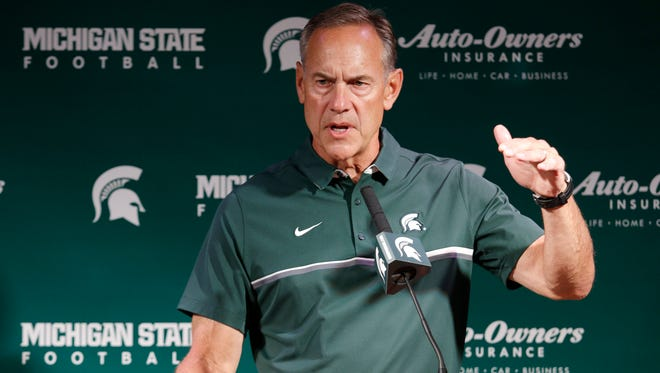 Michigan State football coach Mark Dantonio talks to reporters Aug. 8, 2016, in East Lansing.