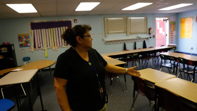 Lead teacher Karen Begay shows off a classroom Thursday at McCormick Elementary School in Farmington, which could see extensive renovations under a plan being presented to the school board.