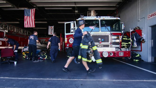 Firefighters at Christiana Fire Company Station 12 prepare to go on a call Sunday, Sept. 25, 2016.