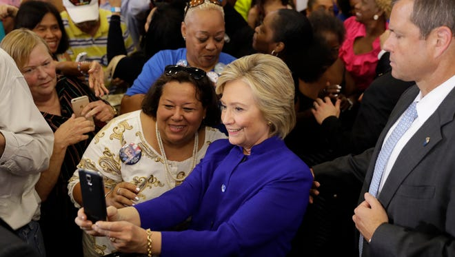 Democratic presidential candidate Hillary Clinton meets with attendees during a campaign stop at the Frontline Outreach Center on Sept. 21, 2016 in Orlando.