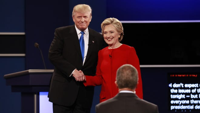 Hillary Clinton and Donald Trump shake hands at the start of their presidential debate at Hofstra University in Hempstead, N.Y., Sept. 26, 2016. (Doug Mills/The New York Times)