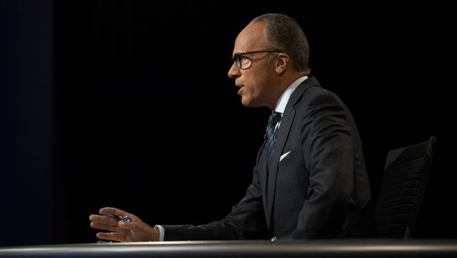 Lester Holt, the moderator for the first presidential debate, between Democratic presidential candidate Hillary Clinton and Republican presidential candidate Donald Trump is seen ahead of the debate at Hofstra University in Hempstead, N.Y., Monday, Sept. 26, 2016. (AP Photo/Matt Rourke)