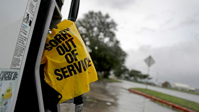 A gas pump sits out of service after Hurricane Matthew knocked out power while passing through St. Simons Island, Ga., Saturday, Oct. 8, 2016.  Matthew plowed north along the Atlantic coast, flooding towns and gouging out roads in its path.