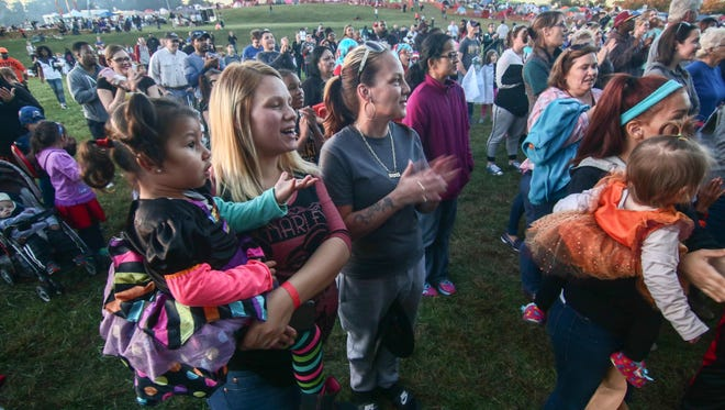Attendees watch a contest during Super Sleep Under the Stars at Carousel Park  Saturday, Oct 15, 2016.