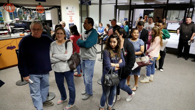 A line forms inside the Santa Clara County Registrar of Voters on  Oct. 24 in San Jose.