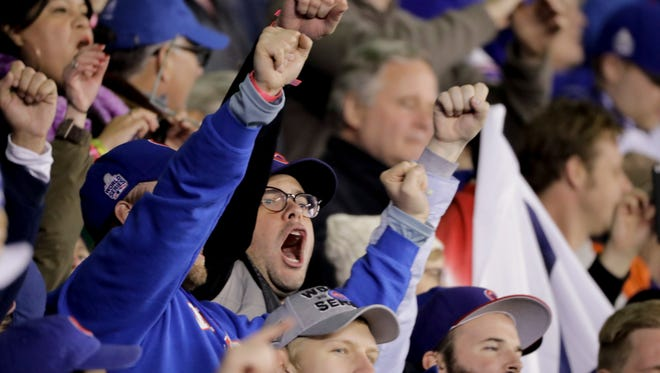 Fans cheer after the Chicago Cubs won Game 5 of the Major League Baseball World Series against the Cleveland Indians Sunday, Oct. 30, 2016, in Chicago. The Cubs won 3-2 as the Indians lead the series 3-2.