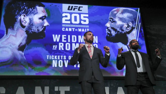 In this Sept. 27, 2016 file photo, UFC middleweight fighters Chris Weidman, left, and Yoel Romero pose for photos during a news conference for UFC 205 in New York. Weidman and Romero were on the first major UFC card to be held in New York after the state legislature legalized the sport earlier in 2016. UFC has held events in New York City and Albany so far, with scheduled events in Brooklyn and Buffalo upcoming.