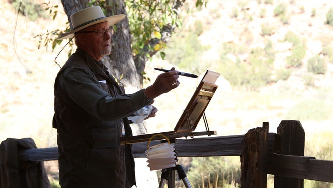 Colorado artist Mike Simpson leads a watercolor demonstration on the Zion History Museum patio Monday. Simpson said, although he's long been a fan of the area's red rocks, it's the first time he's participated in Zion's Plein Air Invitational.