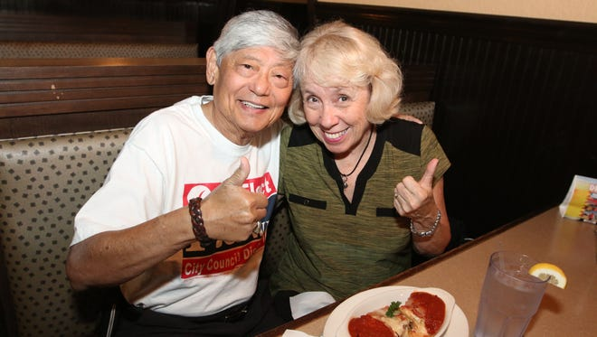 Pensacola City Councilman P.C. Wu and his wife, Judi, celebrate P.C.'s re-election win Tuesday night.