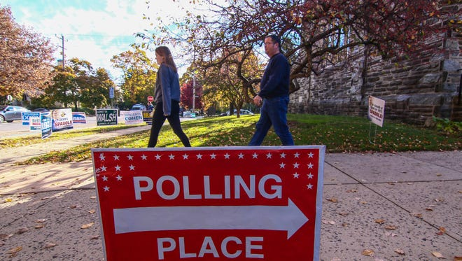 Voters leave the polls after placing their votes at Emmanuel Church in Wilmington on Election Day 2016.