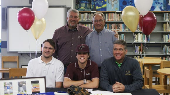 Sterlington High School senior Dalton Dopson signs a national letter of intent signifying his plans to play baseball for the University of Louisiana at Monroe on Wednesday, Nov. 9, 2016.