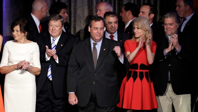 New Jersey Gov. Chris Christie pumps his fist as President-elect Donald Trump gives his acceptance speech during his election night rally Wednesday in New York.