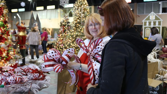 Tree designers set up their displays on Nov. 15, 2016, in preparation for the Jubilee of Trees, which runs Nov. 17-21.