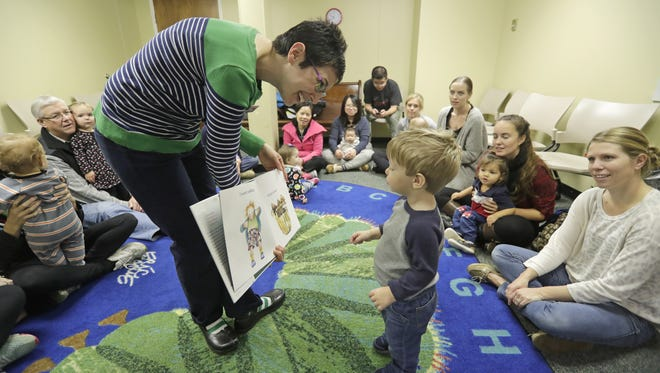 Thirty people are crammed into the story time room last week at the East Branch of the Brown County Library on Main Street. Molly Senechal, a youth services librarian, conducts Baby Story Time at the branch.