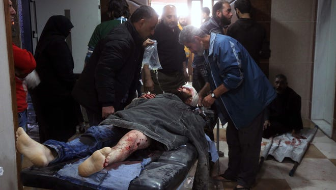 A wounded Syrian receives treatment at a makeshift hospital in eastern Aleppo as regime aircraft and artillery pounded neighbourhoods in the rebel-held east of Syria's second city on Friday.