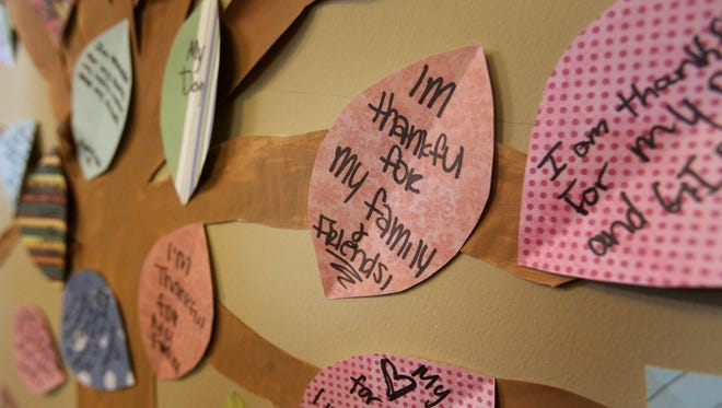 Messages on the leaves of a give thanks tree.