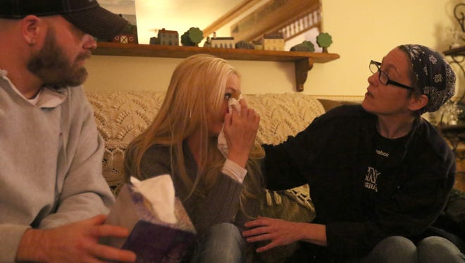 Korinna Dahlke (R), the mother of 8-year-old Ronan Mateer, who has several life threatening cancers, comforts Bethany Rein, the mother of 3-month-old Charlie Rein, who has a life threatening cancer of his own, during the first face-to-face meeting between the Mateer family and the Rein family, on Tuesday, November 15, 2016 in Wisconsin Rapids. The Mateer family donated $3,000 dollars they raised from a benefit for their 8-year-old son, who has leukemia and lymphoma, to the Rein family, whose infant has a rare cancer of his own.