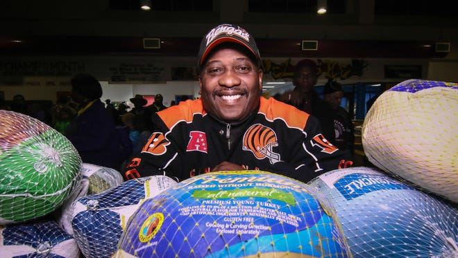 Norman Oliver pose for photo in front of frozen turkeys during the 34th annual NOR Enterprises turkey give away Tues. Nov. 22, 2016, at The Greater Newark Boys & Girls Club in Newark.