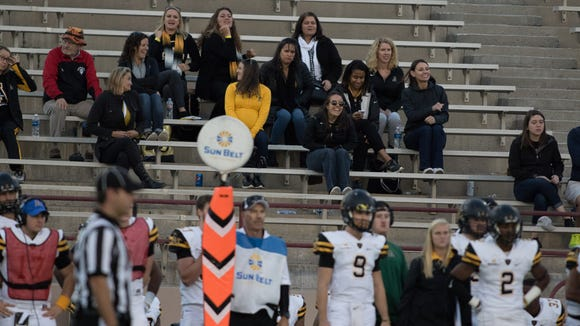 A small but vocal contigent of Appalachian State fans cheering on their team during Saturday's Aggie football game against Appalachian State on November 26, 2016.