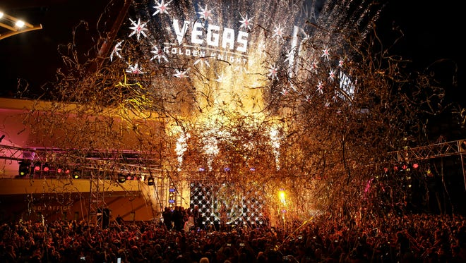 Confetti streams above the crowd during an event to unveil the name of Las Vegas' National Hockey League franchise on Tuesday, Nov. 22, 2016, in Las Vegas.