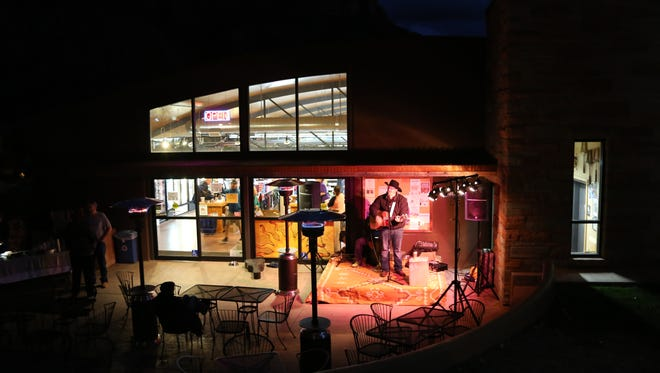 Country music artist Ryan Orton performs Nov. 26 outside of Sol Foods market in Springdale for the town's 7th annual tree lighting celebration.