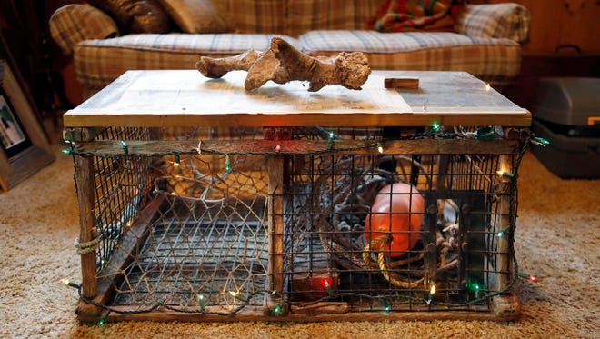 This Nov. 2, 2016 photo shows a discarded lobster trap which was converted into a coffee table by Glenn Adams, at his home in Augusta, Maine.