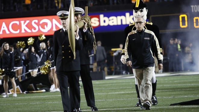 Vanderbilt director of communications Rod Williamson, right, prepares to drop the anchor for the Commodores' win over Tennessee. Williamson is retiring after nearly 34 years at Vanderbilt.