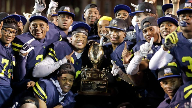 Lausanne Collegiate players celebrate after defeating Knoxville Webb in the Division II Class A Tennessee high school football championship game Thursday, Dec. 1, 2016, in Cookeville, Tenn. Lausanne Collegiate won 12-9. (AP Photo/Mark Humphrey)