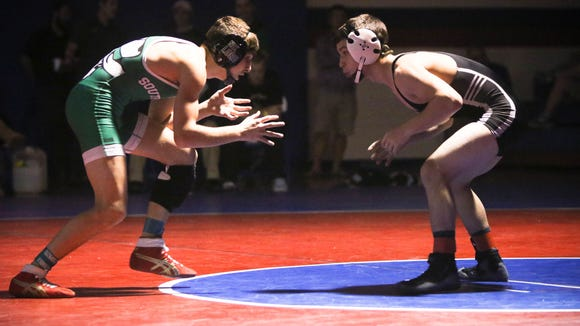 Nik Lord of Southwest Guilford and Kade Millsaps of Robbinsville wrestled at 126 pounds in Saturday's finals of the Falcon Frenzy tournament at West Henderson.