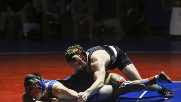 North Henderson's Paul Searcy set a new school record on Saturday at the WMAC wrestling meet with his 195 career win, breaking the old record set by Mitchel Langford.