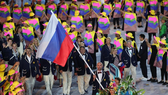 The McLaren report, with the first part released in July, confirmed allegations of widespread doping in Russia. Here, Russian flag bearer Sergei Tetyukhin leads the team during the opening ceremony. The IOC allowed international sports federations to decide which Russian athletes were eligible to compete in Rio.