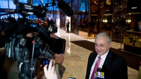 Carl Paladino speaks to members of the media at Trump Tower, Monday, Dec. 5, 2016, in New York. (AP Photo/Andrew Harnik)