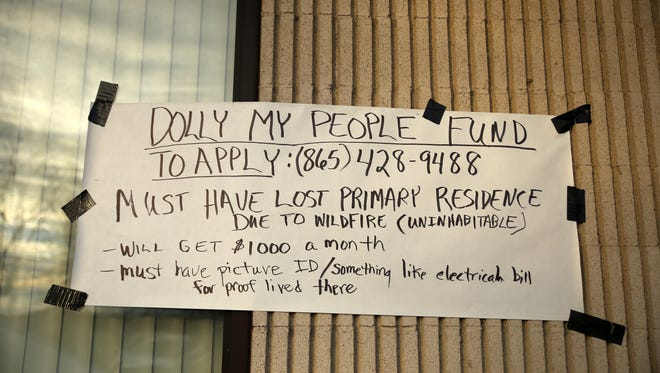 A sign with details about the Dolly My People Fund is taped to the outside of Sevier County Volunteer Rescue Squad Thursday, Dec. 8, 2016. The squad is accepting donations for Sevier County fire victims.