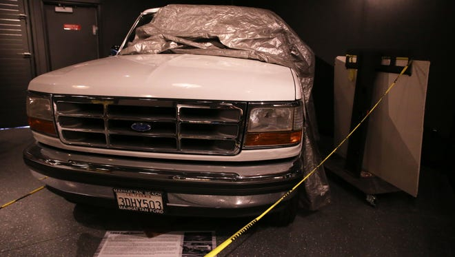 O.J. Simpson's famous Ford Bronco is on exhibit at the the Alcatraz East museum in Pigeon Forge Wednesday, Dec. 7, 2016. This photo was taken before the museum's opening and the vehicle will be on full display (and not partially covered) when the museum opens to the public.