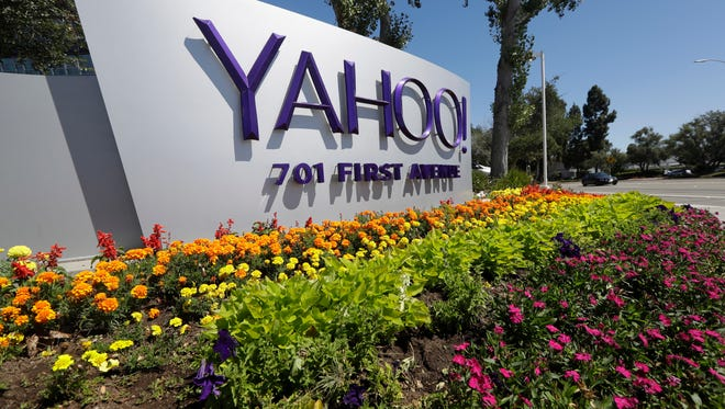 This Tuesday, July 19, 2016 photo shows a Yahoo sign at the company's headquarters in Sunnyvale, Calif. On Wednesday, Dec. 14, 2016, Yahoo said it believes hackers stole data from more than one billion user accounts in August 2013.