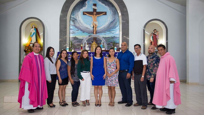 Officers of the Oton Association of Guam: Next Generation are pictured after a Special Mass on Dec. 11  in honor of Oton's patron saint, the Immaculate Conception. From left: Father Mel Camina, Rene Reyes, assistant secretary, Roxie Reyes, treasurer, Jennifer Rioja, assistant treasurer, Hernalin Analista, vice president, Jennifer Olivares Cruz, president, Irish Olivares, secretary, Jay Cruz, public relations officer, Pedro Olivares, charter president, Norman Analista, Filipino Community of Guam President and Oton Association advisor and Father Yong Albite.