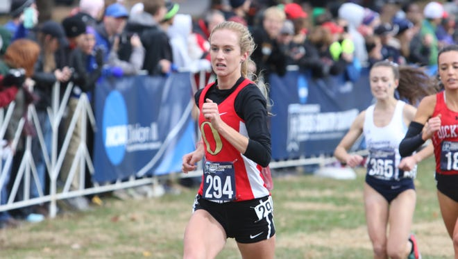 Otterbein University sophomore Claire Lamb from Granville runs to the finish line in Louisville, Ky. during the NCAA Division III Cross Country Championships.