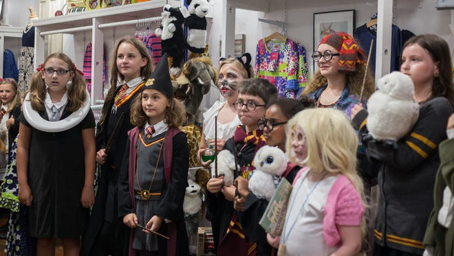Young participants dressed as characters from the magical world of Harry Potter for a costume contest held during the Queen City Mischief & Magic (formerly Potter Party) this past summer.