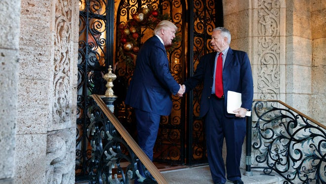President-elect Donald Trump shakes hands with former Wisconsin Gov. Tommy Thompson after meeting at Mar-a-Lago, Wednesday in Palm Beach, Fla.