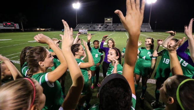 Fort Myers players get pumped up with a cheer before heading out onto the field for their game. The Fort Myers girls soccer team, which has transitioned from a team in past years of individual performers to more of a team working together, beat Bishop Verot 1-0 Tuesday night.