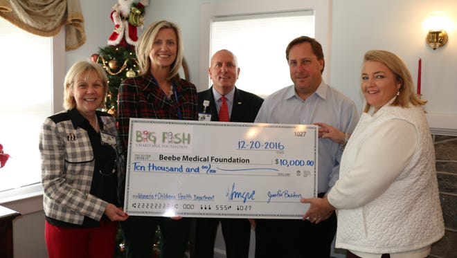 Pictured here, left to right, are:  Judy L. Aliquo, President and CEO of Beebe Medical Foundation; Bridge Buckaloo, MSN, RNC-OB, Executive Director of Women's and Children's Health at Beebe Healthcare;  Thomas J. Protack, Vice President of Development at Beebe Medical Foundation;  Eric Sugrue, owner of Big Fish Grill; and Jennifer Burton with the Big Fish Foundation.