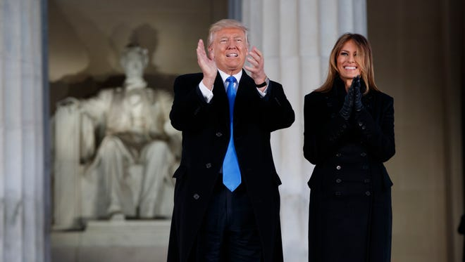 "President-elect Donald Trump, and his wife Melania, arrive to the ""Make America Great Again Welcome Concert"" at the Lincoln Memorial."