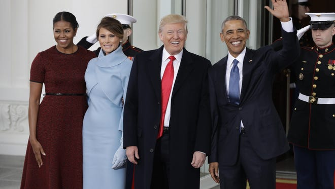 President Barack Obama and first lady Michelle Obama greets President-elect Donald Trump and his wife Melania Trump at the White House in Washington, Friday, Jan. 20, 2017. (AP Photo/Evan Vucci) ORG XMIT: DCEV217